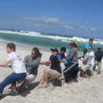 Team building on the beach at Monkey Valley Resort